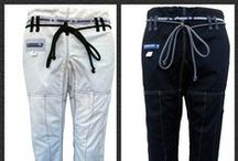 "Gi Pants /  Submission bjj gi pants are extremely durable and long lasting! Made from 100% rip stop material with rope style draw strings, available in colors white, blue & black. We have innovated the jiu jitsu industry by adding 1"" padding along the seams of these pants for extra durability and longevity! All this and still same low price!  We also have a couple Submission Gi pants currently on clearance. (While supplies last)"