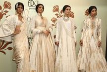 Rohit Bal Couture Collection / Rohit Bal popularised the anarkali from the Moghul era for the modern woman. His collection is timeless as he plays up his signature - volume, the colour ivory and the lotus motif in almost all his collections. Shop his collection with a bridal stylist. Bridelan - Personal shopper & styling services for Indian brides & grooms. Website www.bridelan.com