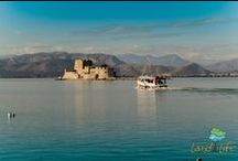 Nafplio city at the region of Peloponnese in Greece / The city of Nafplio is one of the most romantic cities of Greece. Learn about its long history wandering in its picturesque alleys with its neoclassical mansions and Venetian balconies. Walk at the castle of Akronafplia and visit the little peaceful port to board on one of the traditional boats to reach out and explore the Venetian fortress of Mpourtzi.