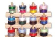 Storage and Batting / Storage for your thread spools and bobbins. June Tailor's patented Low Loft Fusible Batting in craft, crib, twin, queen and full sizes..