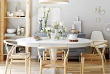 Kitchen/dining area inspiration / Clean, clutter free dining area, w a Scandinavian aesthetic. Rustic kitchen w/ copper pots and pans. Variety of plates and tableware. Open shelves and a convenient pantry