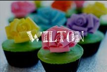 Moore: Wilton®  / For over 80 years, Wilton® has empowered treat decorators of all skill levels by providing the education, tools, and decorating ideas they need to succeed. Learn tips & tricks, recipes and more!! / by A.C. Moore Arts & Crafts