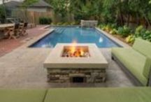 Outdoor Oasis & Pool / Landscape Plus Ltd. was approached by a client with a tight space for a beautiful backyard. Challenge accepted. It included a swimming pool/water feature, a main floor elevation high above pool grade with upper seating and a BBQ, an eating area, a gas firepit with seating for six, a fully plumbed stone change room/toilet, an outdoor shower, and deep lush garden beds.