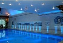Lighting Swimming Pools / Fibre optic lighting systems are ideal for lighting swimming pools because there is no electricity at the light output and no underwater bulbs that will ever require changing.  The pool is illuminated using finest glass fibre optic cables and lenses that transmit light from a powerful lightsource situated outside the area of the pool in an easily accessible, dry location.  In terms of ease of maintenance, there is no better solution for lighting your pool.