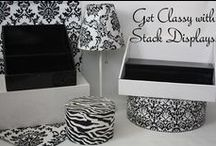 Using Props, Fabric & Accessories with your Stack Displays / Add visual interest to your display by adding fabrics or accessories that compliment your products, but do NOT compete with them!