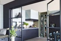 Room dividers / Highlighting the use of sliding doors as room dividers in multi functional living spaces