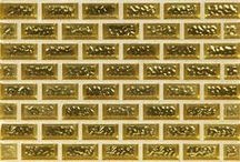 Venetian / Capture the ornate design of one of Italy's most glittering cities with the Venetian collection by Stone & Pewter Accents. Artisans fuse 18K yellow gold and white gold with handcrafted glass tile to create a surface that glows with warmth and luxury.