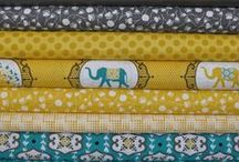 teal, yellow, grey color scheme
