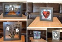 Displaying Stained Glass Panels / Contemporary stained glass no longer has to be set into window frames. Most work made at Radiance Stained Glass is for display on stands or to be hung near sources of light. Many of our small to medium panels are mounted on 'host' windows with strong but removable tape. Other ways to display stained glass panels are shown on this board.