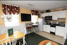 One bedroom Suites / These suites include a bedroom with a king size bed, a kitchenette, living room/dining room space with a queen pull-out sofa. They are also available in Ocean Front.