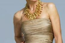 """Gold Anniversary Dresses / 50th Wedding Anniversary Parties are true times of celebration, and what better way to celebrate than with an """"I feel fabulous"""" dress? Whether it's a fun and festive cocktail party or an elegant evening affair, find the perfect 50th anniversary party dress for the """"golden"""" celebration."""