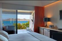 Ocean Deluxe Terrace / The Ocean Deluxe Terrace rooms have a garden access, slightly raised, and are located on the cape, offering the finest sea views. The concept of one large open area offers 322 square feet of comfortably designed room. A 100 square feet terrace fitted with a teak lounge with a double sofa lounger. Generously sized rain shower and designers granite bathtub. / by Hotel Christopher St Barth