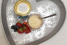 Cake Jars of Delight / Our specialities are cupcakes and mini cakes and we are proud to present our Cake Jars of Delight. Lots of delicious flavours of cakes are baked in the jars themselves and then iced as simply or decadently as you could wish.  Unlike cupcakes, which must be eaten almost immediately, being in a jar means that the Cake Jars of Delights keep fresh for up to 7 days in the fridge – well in theory anyway…you know you won't be able to resist them!