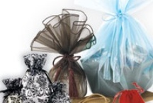 Product: FABRIC BAGS / Fabric Bags from Bags & Bows come in a variety of different styles and materials. They are perfect for packaging jewelry, candles, wine & more. Find examples of our most popular fabric gift bags.