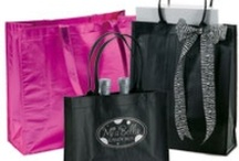 Product: REUSABLE BAGS / Reusable Bags from Bags & Bows come in various colors and styles and are customizable for your shop. With Bags & Bows' reusable bags, your customers can shop in style with greater ease. Find examples of our most popular reusable shopping bags.