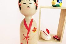 kokeshi - kijiyama / Kijiyama is one of the 11 strains of traditional kokeshi dolls. Kijiyama dolls are usually made out of a single pioece of wood, whereas the craftsmen from other traditions usually assemble body and head together. Kijiyama kokeshi often wears kimono or apron, with stripes or various patterns. The tradition is still strong in Akita prefecture.