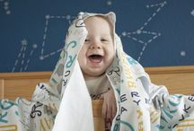 Our Products / Check out our organic cotton baby and toddler blankets, quilts, cloth books, pillows and toys.