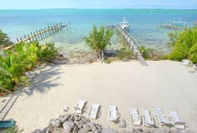 FOR SALE ~ 106 Coastal Drive, Key Largo / WHITE SAND BEACH HOME! Sitting on the open bay with deep water boat dockage and pool in a private, gated community of only 15 estate homes. Both the home and grounds are newly upgraded with charming island details, a new boat lift and 2 jet ski davits. Enjoy wide porches and plenty of entertaining area to share nightly watercolor sunsets over shimmering water. | Price upon request.