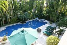 RENTED ~ 114 W Rivo Alto Terrace / Private tropical oasis on Rivo Alto Isl. Charming home on lot & 1/2 surrounded by lush gardens. Enter thru double glass doors to living space w fireplace & columns imported from Bali. Updated kitchen w SS apps, gas stove, built-in wine cooler & espresso machine. Master suite w french doors to pool/patio & huge marble bath w skylite, jacuzzi & separate shower. 2 guest bedrooms; 1 as office w custom shelving. Rooftop deck overlooking pool, hot tub & gardens | List Price: $7,800 p/ Month