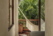 // LA TERRASSE // / La terrasse. Nous pourrions aussi renommer ce lieu : royaume du farniente. Prolongement d'une pièce comme la chambre ou le salon, c'est une invitation au repos. Pour nos repas, nos apéros, nos lectures au rythme du hamac, réchauffé par les rayons de soleil à travers les canisses et les douces odeurs de fleurs…
