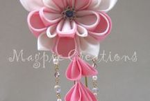 paper flowers / crafty creations; paper, ribbon, clay, beads etc