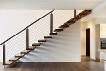 Modern Staircase Remodeling Ideas / Modern stair remodeling components are quickly becoming the preferred style of interior design. With the use of sleek and simplistic style lines, our expertly crafted stair parts can be used to create even the most complicated modern staircase. Many of our Modern parts are available in hollow or solid wrought iron, and are carried in a Satin Black or Ash Grey powder-coated finish. Clients have the option to choose from our iron, stainless, wood, or cable rail systems to create a desired look.