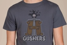 """Houston Gushers Awesome T-shirt / We love this cool t-shirt with a wood Derek that also is the letter """"H"""" gushing with oil."""