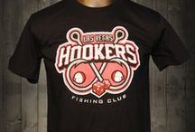 """Las Vegas Hookers Fishing Club Awesome T-shirt / By joining this club, you are guaranteed to eventually catch something. Unfortunately, what you catch might have you heading to the clinic and not the cutting board and kitchen. This brings new meaning to """"Fresh Catch"""" of the day.  At Awesome Sports Logos, we love the sport of fishing and we love the innuendo in this awesome t-shirt. Besides, """"What happens in Las Vegas, stays in Las Vegas."""""""