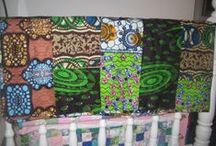 Ugandan Quilt / In between all the festivities, I stitched a quilt.  This lost wax fabric sample quilt, made from fabric produced at a local factory, is the first step to setting up a community quilt making co-operative in Jinga, Uganda.  For more project details, see; http://lisawatsonmakerandeducator.wordpress.com/2014/01/