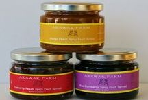 Spicy Fruit Spreads  / Arawak Farm Spicy Fruit Spreads provide uniquely flavorful combinations with a hint of Habanero pepper. Unlike traditional fruit-based products that are presently available in the marketplace, our product delivers thick, velvety textures with lower sugar content! The Spicy Fruit Spreads are great as a glaze on roasted meats, an added surprise filling for puff pastry, or warmed and poured over ice cream. Either way... we deliver the sweet and the heat!