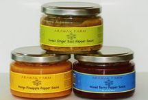 Pepper Sauce / Arawak Farm Pepper Sauces offer unique combinations and textures that will enhance your food preparation and excite your palette.  When used over a range of meats, poultry, seafood, cheeses and yes even desserts; we promise to bring the flavor and the heat!