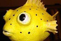 Fish >---i>