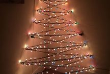 DIY 3-D wall light Christmas tree  / Tired of hassling around a real or fake tree? How about a DIY wall light tree? I got even a better idea why not make a 3-D wall light tree? I've been seeing a lot of DIY wall Christmas trees on Pinterest and my clever husband came up with this 3-D tree. I love it!!