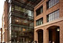 FORGE: 235 2nd Street / #Rehabilitation #Architecture #CorporateOfficeBuilding #Brick #Atrium #FeatureStair #GlassAndBrick #CommercialArchitecture #OfficeSpace #Lobby #BrickColonnade