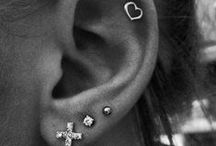 .Ear piercings.