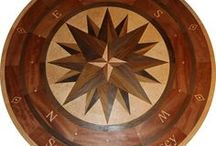 """Surf City Compass Rose Floor Medallion / 60"""" Custom longitude and latitude hardwood floor compass rose inlay.   This #floormedallion sits at the bottom of a gorgeous #SpiralStaircase  http://www.rosefarminlays.com"""