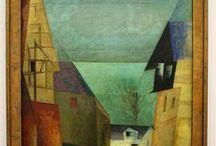 Lyonel Feininger(1871-1956) / Γερμανο-αμερικανός καλλιτέχνης και κορυφαίος εκφραστής του εξπρεσιονισμού.Γεννήθηκε και μεγάλωσε στη Νέα Υόρκη.Ξεκίνησε την καριέρα του ως σκιτσογράφος το 1894 και για 20 χρόνια γελοιογράφος σε περιοδικά και εφημερίδες,τόσο στη Γερμανία όσο και στις Ηνωμένες Πολιτείες.Ήταν ένας από τους ιδρυτές του σχολείου Bauhaus της τέχνης και της αρχιτεκτονικής.