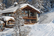 Chalet Le Chardon, Val d'Isere, France / We love the impressive outdoor area, with large pool, 2 hot tubs and lots of space to lounge beneath patio heaters while you drink in the mountain view.