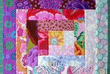 Quilts / One who sleeps under a quilt is comforted by Love...
