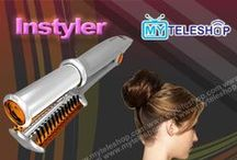 In Styler / It's not a brush. It's not a flat iron. It's not a curling iron. It's the InStyler® rotating hot iron!