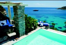 Mykonos Blu, Grecotel Exclusive Resort - Mykonos / Nestled in the cosmopolitan island, discovered by jet setters, are the island bungalows and private villas of Mykonos Blu luxury hotel, thoughtfully designed to reflect the cubist lines of the Cyclades. Set on a low bluff overlooking the world-famous beach at Psarou, this dream luxury hotel in Mykonos floats on the edge of an Aegean fantasy, just like the unique infinity pool that seems to hover in the air.