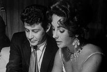 Elizabeth Taylor and Singer Eddie Fisher / After Mike's untimely death, Elizabeth widowed all alone,devastated and needed security fortunately she found love and comfort in the arms of Eddie (her deceased husband's according to his autobiography best friend) .They embarked on an affair while he was married to Debbie Reynolds. Taylor and Fisher were married at the Temple Beth Sholom in Las Vegas on May 12, 1959. She later stated that she only married him due to grief they divorced March 6 1964