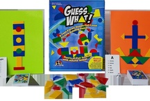 Guess What Game / EduStic's Guess What! Game.  Includes:  108 EduStic Geometric Shapes, 81 Guess What Cards, 27 Guess What Jr. Cards, 2 Laminated Storage Sheets/Playboards, 1 Die, 1 Sand Timer.  $24.99 Retail.