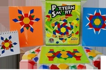 Pattern Smart Game / EduStic's Pattern Smart Game.  Includes:  213 EduStic Pattern Blocks, 3 Laminated Storage Sheets/Playboards, and 45-page Flipchart.  $26.99 retail.