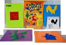 Tangram Smart Game / EduStic's Tangram Smart Game.  Includes:  4 EduStic Tangrams, 4 Laminated Storage Sheets/Playboards, and 45-page Flipchart.  $24.99 retail.