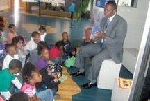 Weldon Elementary School Storytime Tour / Seventy-seven Kindergarten students from Weldon Elementary School attended a Storytime Reading Program with Weldon City Schools Superintendent Dr. Elie Bracy III as Guest Reader at the Roanoke Canal Museum. Students toured the museum following the reading.