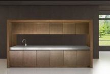 Kuche Pocket Kitchens / To create flexible kitchen spaces an increasingly popular design option is a sliding door system for kitchens known as kitchen pocket doors. This innovative kitchen design system is a stylish kitchen feature within itself, high in quality and appearance but also extremely functional. Kitchen pocket doors are intended for housing but also concealing storage and/or appliances within tall kitchen units, more-often within open plan kitchens or studio apartments.