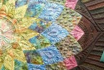 Beautiful Quilts / Amazing artistry ~ both in the use of fabric & in stitching!