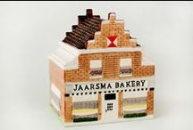 Jaarsma Gifts / Jaarsma Bakery offers a variety of coffee mugs, drinking containers, and custom shopping bags. We also have a beautifully designed replica cookie jar of our old world, Dutch styled, bakery building to store all your delicious cookies and pastries from Jaarsma Bakery.