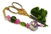 TJBdesigns / All the needlework BLING you could ever want. Scissor fobs, stitch markers for crochet and knitting, counting pins for cross stitch and needlepoint, laying tools/stilettos for needlepoint, quilting, sewing, needle threaders